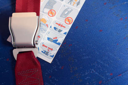 or instruction: Locked seatbelt and instruction lay on the chair. Stock Photo