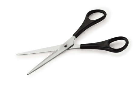Stationery steel scissors with black plastic handle on white background  photo