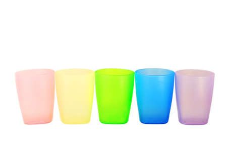 five objects: Colorful plastic glasses of various color isolated on white background