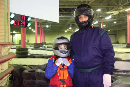 carting: little boy and his carting trainer are standing in helmets; ground for carting Stock Photo