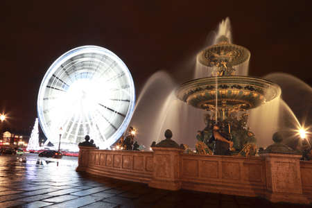 Fontaine des Mers, Christmas tree and a Ferris wheel at the Place de la Concorde in Paris. photo