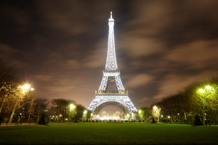 eiffel tower: PARIS - DECEMBER 29: Eiffel Tower illuminated at night, view from the Champs de Mars, December 29, 2009, Paris, France. It was named after its creator - Gustave Eiffel.