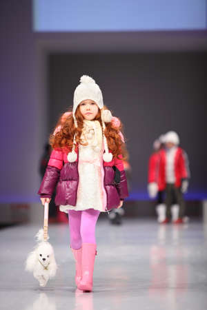 MOSCOW - FEBRUARY 22: Unidentified child model wear fashions from Snowimage and walk the catwalk in the Collection Premiere Moscow, an international fashion fair for Eastern Europe, on February 22, 2011 in Moscow, Russia.