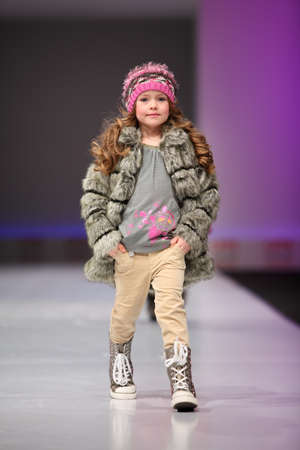 defile: MOSCOW - FEBRUARY 22: Unidentified pretty child model wear fashions by Snowimage and walk the catwalk in the Collection Premiere Moscow, an international fashion fair for Eastern Europe, on February 22, 2011 in Moscow, Russia.