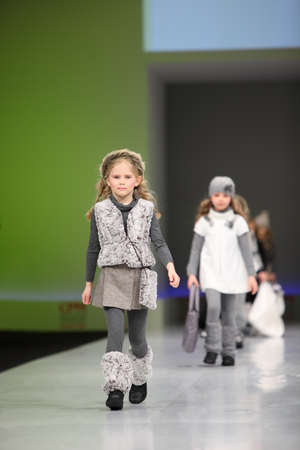 MOSCOW - FEBRUARY 22: Unidentified pretty child models wear fashions by Snowimage and walk the catwalk in the Collection Premiere Moscow, an international fashion fair for Eastern Europe, on February 22, 2011 in Moscow, Russia.