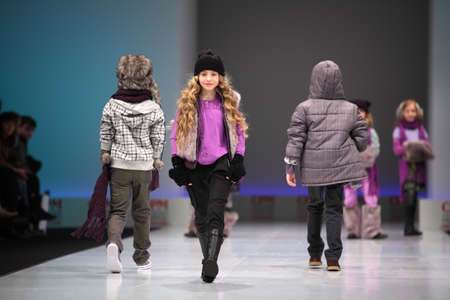 defile: MOSCOW - FEBRUARY 22: Unidentified child models wear fashions from Snowimage and walk the catwalk in the Collection Premiere Moscow, main platform of fashion industry in Eastern Europe, on February 22, 2011 in Moscow, Russia. Editorial