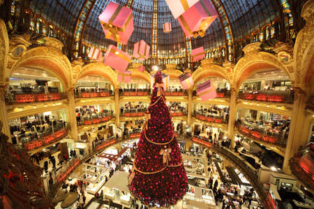 lafayette: PARIS - DECEMBER 30: The Christmas tree at Galeries Lafayette, trade pavilions with perfume, view from the upper gallery, December 30, 2009, Paris, France. This store is one of the symbols of Paris.