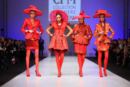 defile: MOSCOW - FEBRUARY 22: Four women in red suit from Slava Zaytzev on catwalk in CPM on February 22, 2011 in Moscow, Russia. Collection Premiere Moscow - fashion industry platform of IGEDO Company