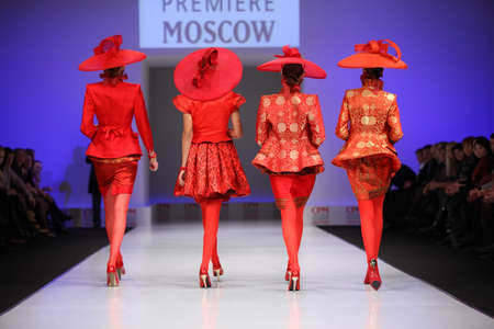 defile: MOSCOW - FEBRUARY 22: Backs of four women wear red suits from Slava Zaytzev walk the catwalk in the Collection Premiere Moscow, a fashion industry platform of IGEDO Company, on February 22, 2011 in Moscow, Russia.
