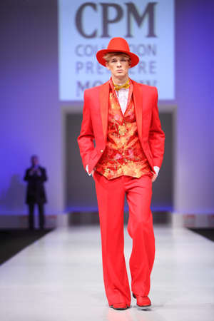 defile: MOSCOW - FEBRUARY 22: Man wear red suit from Slava Zaytzev walk the catwalk in the Collection Premiere Moscow, a leading fashion fair in Eastern European market,  February 22, 2011 in Moscow, Russia.