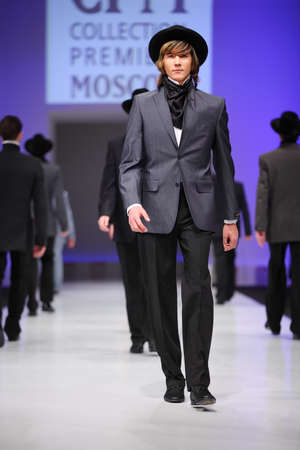 defile: MOSCOW - FEBRUARY 22: Mans wear suits from Slava Zaytzev walk the catwalk in the Collection Premiere Moscow, a leading fashion fair in Eastern European market, on February 22, 2011 in Moscow, Russia.