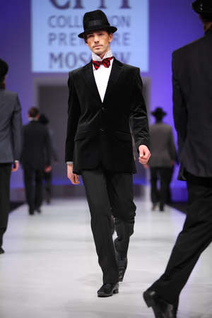 defile: MOSCOW - FEBRUARY 22: Mans wear black suits from Slava Zaytzev walk the catwalk in the Collection Premiere Moscow, a leading fashion fair in Eastern European market, on February 22, 2011 in Moscow, Russia.