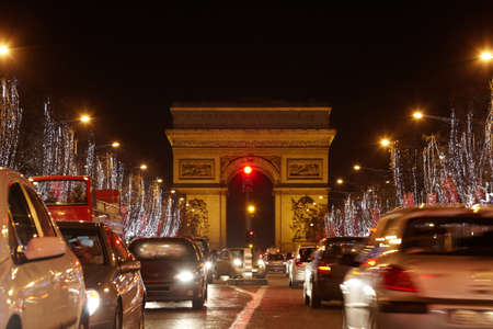 bounded: PARIS - JANUARY 1: Avenue des Champs Elysees and Triumph Arch at night, January 01, 2010, Paris, France. From one side Avenue des Champs Elysees is bounded by the Arc de Triomphe, on the other - Place de la Concorde. Editorial