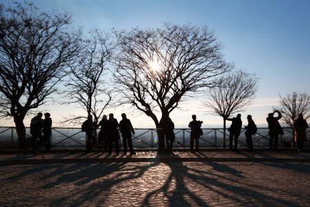 shadowgraph: Tourists in Paris on observation platform looking at panorama of city