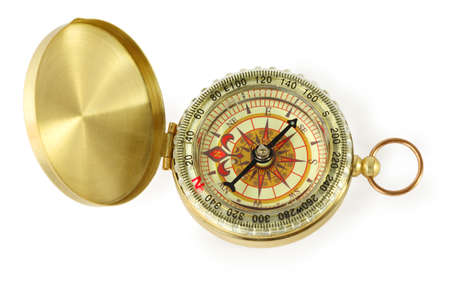 exactness: beautiful golden compass with black needle isolated on white Stock Photo