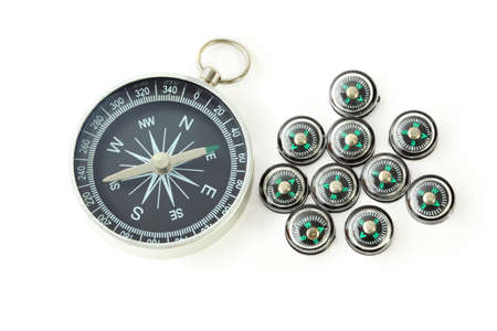 exactness: big compass with ten black small compasses isolated on white
