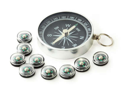 exactitude: big compass with eigth black small compasses isolated on white