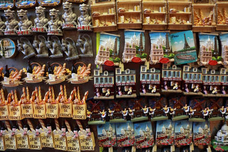 souvenir traditional: PARIS - JANUARY 3: Few rows of magnet souvenirs on January 3, 2010 in Paris, France. According Global Blue, Chinese, Russians, Indians and Brazilians more spend than other tourists in Paris