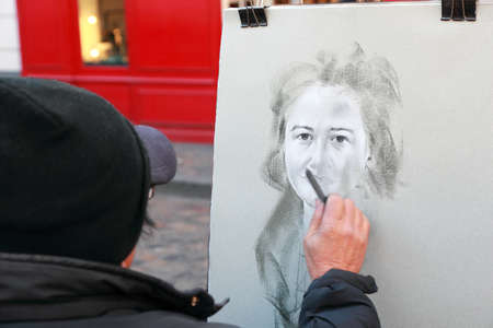 PARIS - JANUARY  3: Artist paints monochromatic portrait of woman on Montmartre on January 3, 2010 in Paris, France. Hill of Montmartre is highest point in Paris