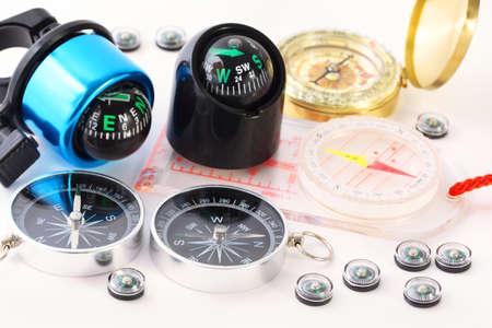 exactness: Fifteen different multi-colored compasses - golden vintage compass, black plastic compass