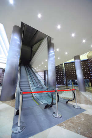 conducts: Escalator in large hall  which is closed barrier Editorial