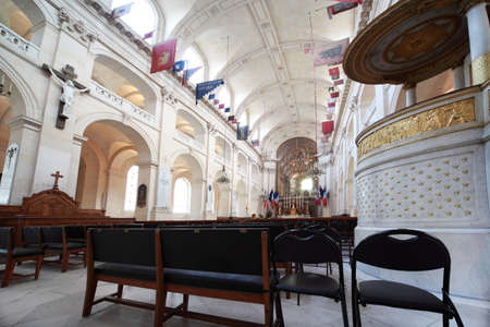 Inside Cathedral of St. Louis (cathedrale Saint-Louis-des-Invalides), famous so that it is buried Napoleon, in Paris, France, focus on chairs