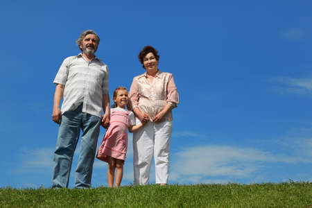 little girl and her grandparents standing on lawn and holding for hands Stock Photo - 17724293