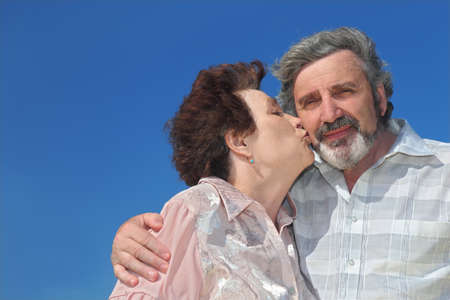 portrait of old woman kissing man cheek, blue sky Stock Photo - 17724615