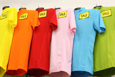 Variety of multicolored casual clothes in shop; T-shirts worn by mannequins Stock Photo - 17677309