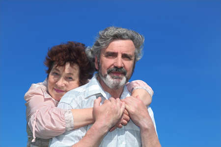 old woman embracing man from back, blue sky Stock Photo - 17724530