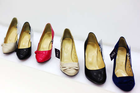 Row of six various women shoes in shop; new collection; attractive discounts Stock Photo - 17674268