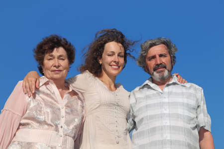 portrait of adult daughter and her parents embracing, blue sky Stock Photo - 17724510