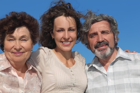 portrait of adult daughter and her parents smiling, blue sky Stock Photo - 17724640