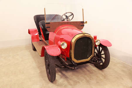 MOSCOW - JANUARY 19: Antique red car in museum of Mosfilm on January 19, 2010 in Moscow, Russia. In museum of Mosfilm Cinema Concern collected property from movies