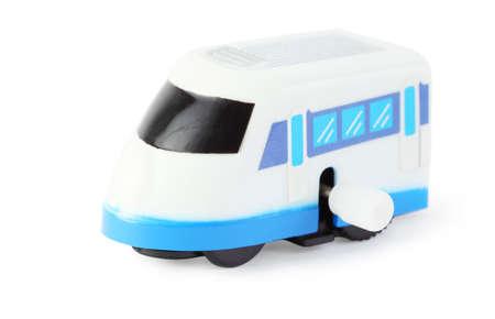 cartage: bright clockwork toy white train with blue windows on white background Stock Photo