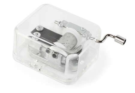 warble: little clockwork toy transparent musical box on white background