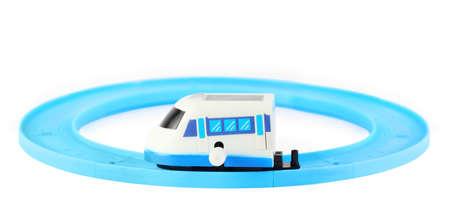 cartage: bright clockwork toy white train with blue windows on railroad on white background