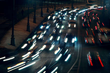moving traffic at night with moving lights at winter; many cars Stock Photo