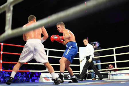 ring stand: MOSCOW - JANUARY 08: Home match  Arustamyan (L) &quot,Kremlin bears&quot, (Russia) vs. PARIS UNITED (France) Aleksis  Vastin (R) in concerto hall  BARVIKHA LUXURY VILLAGE, January 08, 2011 in Moscow , Russia. In framework WSB boxers  get possibility effec