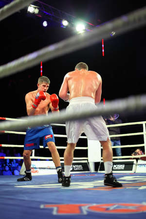 concerto: MOSCOW - JANUARY 08: Third home match of Kremlin bears (Russia) David Arustamyan (R) and PARIS UNITED&raquo, (France) Aleksis  Vastin (L)  in concerto hall  BARVIKHA LUXURY VILLAGE, January 08, 2011 in Moscow , Russia. WSB offers to boxers not having anal