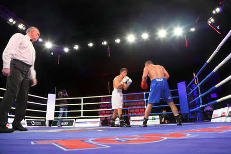 ref: MOSCOW - JANUARY 08:  Light heavyweight (85 kg) Denis Caryuk (L) Kremlin bears (Russia) vs. Khrvozhe Sep (R) PARIS UNITED (France) in concerto hall  BARVIKHA LUXURY VILLAGE, January 08, 2011 in Moscow , Russia. WSB will inspire and support young gifted sp Editorial
