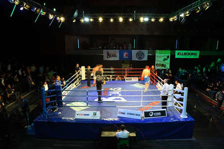 ring stand: MOSCOW - JANUARY 08: Heavyweight (91 kg): Islam Ismailov (L) Kremlin bears (Russia) vs. Filip Khrgovich (R) PARIS UNITED (France)  in concerto hall  BARVIKHA LUXURY VILLAGE, January 08, 2011 in Moscow , Russia. World Series of Boxing (WSB) is  boxing comp