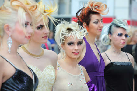 MOSCOW - OCTOBER 2: Five models with fanciful hairdo at XVII International Festival World of Beauty - 2010 in exhibition complex Gostiny Dvor, on October 2, 2010 in Moscow, Russia.