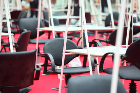 commodious: rows of black armchairs, white tables and mirrors at Competition of Hairdressing Art