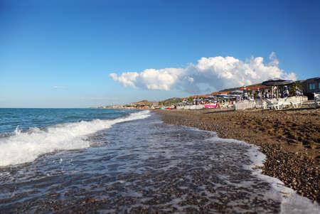 mandatoriccio: blue water of sea, far away beach, mountains and building of sanatorium