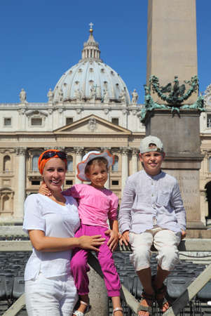 beautiful young mother, little daughter and son on Piazza San Pietro in Rome, focus on mother Stock Photo - 17723695