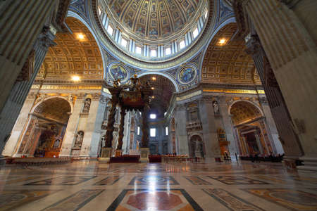 Indoor view of Basilica di San Pietro in Rome, Italy, beautiful gold finishing
