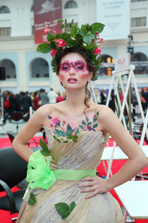 MOSCOW - OCTOBER 2: Beautiful young model with bodyart Spring at XVII International Festival World of Beauty - 2010 in exhibition complex Gostiny Dvor, on October 2, 2010 in Moscow, Russia. Stock Photo - 17678611