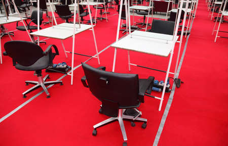 cleanly: rows of black chairs, white tables and mirrors for hairdressers for competition of hairdressing Stock Photo