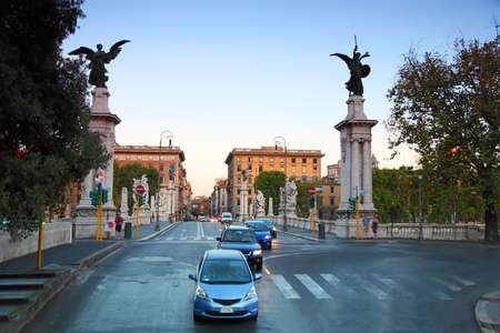 vittorio emanuele: Cars go on Ponte Vittorio Emanuele II in Rome, Italy, beautiful sculptures
